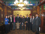 Paul Zane Pilzer with Li Daning (Director of the Administration of Traditional Chinese Medicine) and Meijun (Vice President of Tangrentong), among others (December 2009)